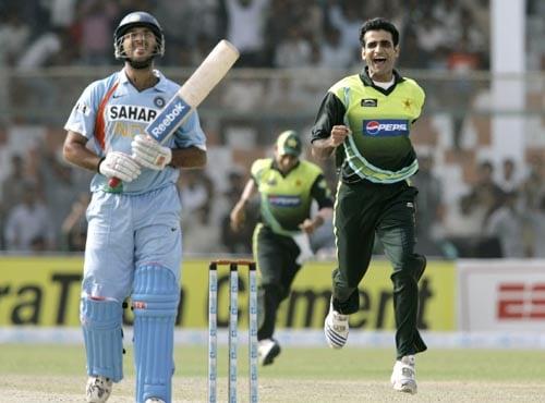 Yuvraj Singh walks back after being dismissed against Pakistan.