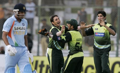 Pakistan celebrate the dismissal of Rohit Sharma in their Asia Cup game.