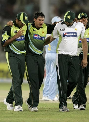 Pakistan opener Nasir Jamshed is helped off the pitch after he retired hurt due to exhaustion.