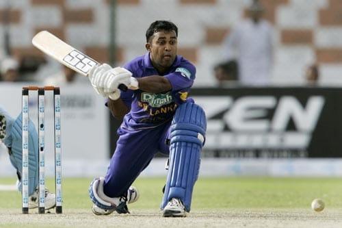 Chamara Silva prepares to sweep against India in Karachi.