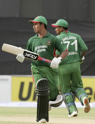 Bangladesh captain Mohammad Ashraful and Raqibul Hasan take a run against the UAE in Lahore on Tuesday.