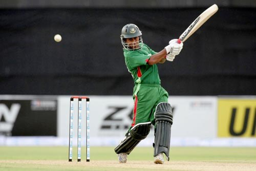 Bangladesh captain Mohammad Ashraful drives on the up against the UAE in Lahore on Tuesday.