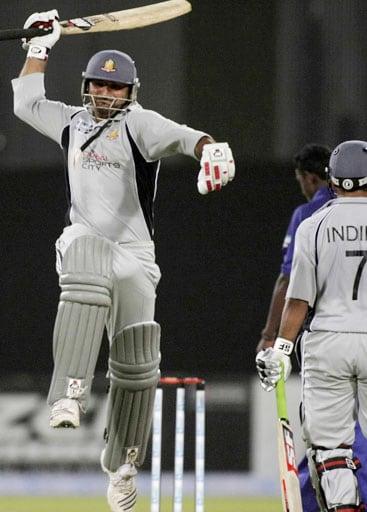 United Arab Emirates batsman Amjad Ali, celebrates his fifty against Sri Lanka during the Asia Cup Cricket Championship at Gaddafi Stadium in Lahore, Pakistan on Thursday, June 26, 2008.