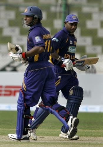 Sanath Jayasuriya and Kumar Sangakkara take a run during their 201-run partnership against Bangladesh in Karachi.