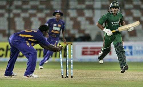 Bangladesh batsman Nazim Uddin is run out by Sri Lanka spinner Ajantha Mendis during their match in the Asia Cup.