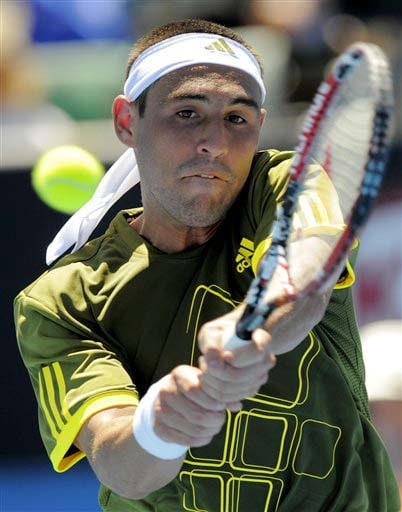 Marcos Baghdatis of Cyprus returns the ball to France's Julien Benneteau during their men's singles match at the Australian Open in Melbourne on Monday. (AP Photo)
