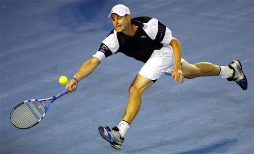 Andy Roddick stretches to return to Roger Federer during their men's singles semifinal match at the Australian Open in Melbourne.