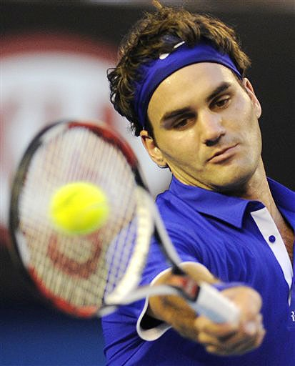 Roger Federer makes a return to Andy Roddick during their men's singles semifinal match at the Australian Open in Melbourne.