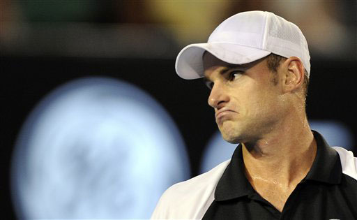 Andy Roddick reacts as he plays Roger Federer during their men's singles semifinal match at the Australian Open in Melbourne.