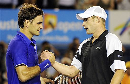 Roger Federer greets Andy Roddick after winning their men's singles semifinal match at the Australian Open in Melbourne.
