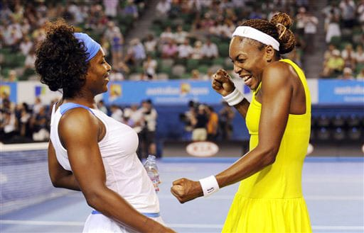 Serena Williams and her sister Venus of the United States celebrate after beating Japan's Ai Sugiyama and Daniela Hantuchova of Slovakia in the Women's doubles final at the Australian Open in Melbourne.