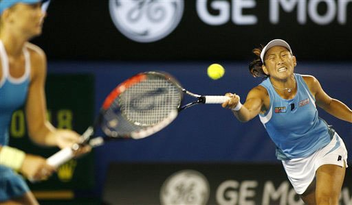 Japan's Ai Sugiyama returns the ball as she and Daniela Hantuchova of Slovakia play Venus and Serena Wiilliams of the United States in the Women's doubles final at the Australian Open in Melbourne.