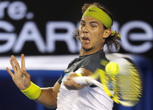 Spain's Rafael Nadal returns the ball to Belgium's Christophe Rochus in a men's singles match at the Australian Open in Melbourne on Tuesday. (AP Photo)
