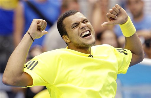 France's Jo-Wilfried Tsonga celebrates after beating Argentina's Juan Monaco during their men's singles match at the Australian Open on Tuesday. (AP Photo)