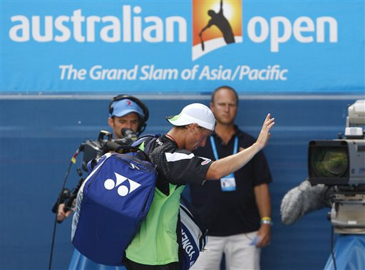 Australia's Lleyton Hewitt leaves the court after losing to Chile's Fernando Gonzalez during a men's singles match at the Australian Open on Tuesday. (AP Photo)