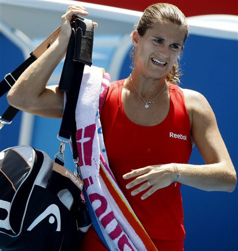 France's Amelie Mauresmo walks off the court after defeating Beralus' Olga Govortsova during a women's singles match at the Australian Open on Tuesday. (AP Photo)