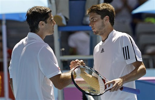 France's Gilles Simon greet Spain's Pablo Andujar at the net after beating him in their men's singles match at the Australian Open on Tuesday. (AP Photo)