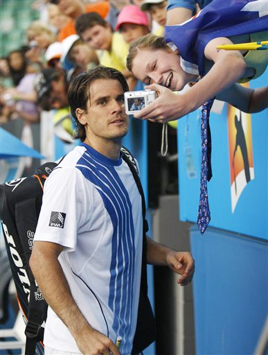 Germany's Tommy Haas poses for a photo for a spectator after beating Argentina's Eduardo Schwank in a men's singles match at the Australian Open on Tuesday. (AP Photo)