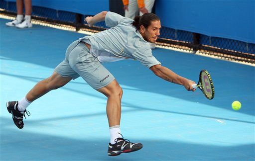 Argentina's Guillermo Canas stretches for a return to Germany's Dieter Kindlmann during their men's singles match at the Australian Open on Tuesday. (AP Photo)