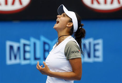 India's Sania Mirza reacts as she plays Russia's Nadia Petrova in a Women's singles match at the Australian Open in Melbourne.