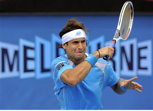 Spain's David Ferrer returns to Slovakia's Dominik Hrbaty during a Men's Singles match at the Australian Open in Melbourne.