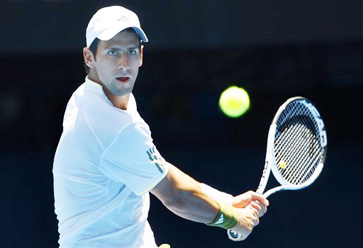 Novak Djokovic of Serbia returns to Jeremy Chardy of France during a Men's singles match at the Australian Open in Melbourne.