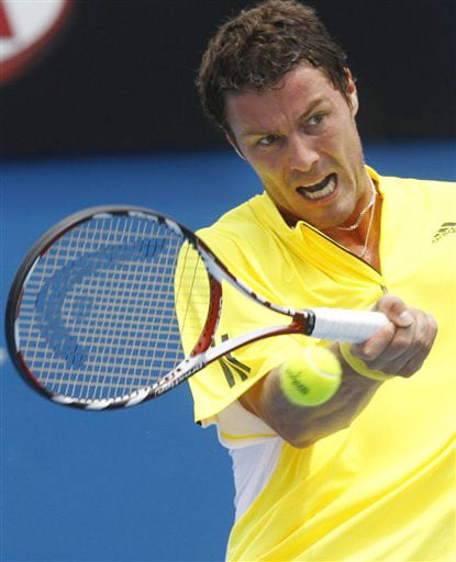 Russia's Marat Safin returns to Spain's Guillermo Garcia-Lopez during their Men's Singles match at the Australian Open in Melbourne.