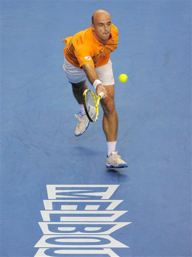 Croatia's Ivan Ljubicic lunges for the ball to return to France's Jo-Wilfried Tsonga during their men's singles match at the Australian Open in Melbourne on Thursday. (AP Photo)