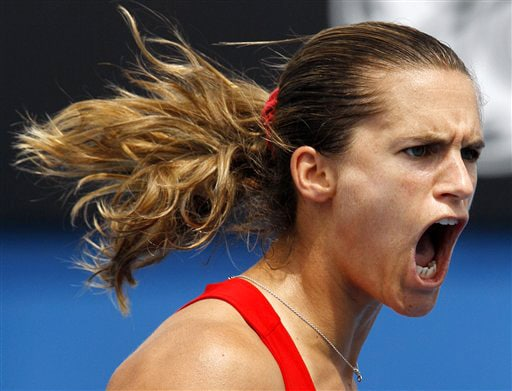 France's Amelie Mauresmo reacts to winning a point against Britain's Elena Baltacha during their women's singles match at the Australian Open in Melbourne on Thursday. (AP Photo)