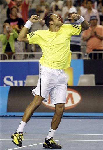 France's Jo-Wilfried Tsonga celebrates after beating Croatia's Ivan Ljubicic during their men's singles match at the Australian Open in Melbourne on Thursday. (AP Photo)