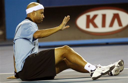 James Blake of the United States falls down as he plays France's Sebastien De Chaunac during their men's singles match at the Australian Open in Melbourne on Thursday. (AP Photo)