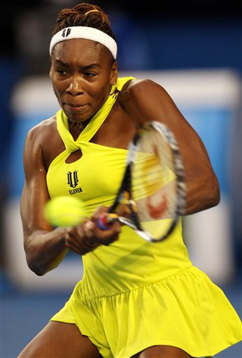 Venus Williams of the United States returns to Carla Suarez Navarro of Spain during their women's singles match at the Australian Open in Melbourne on Thursday. (AP Photo)