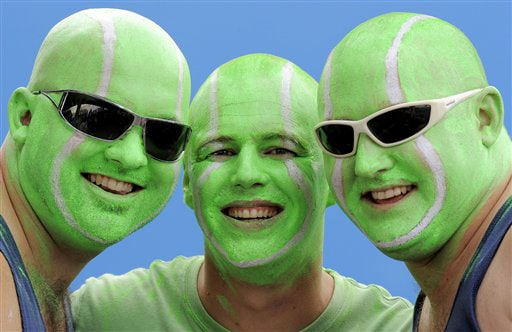 Tennis ball-painted fans pose for photo at the Australian Open in Melbourne on Thursday. (AP Photo)