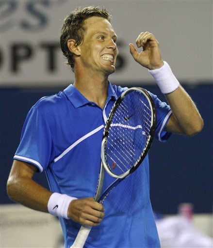 Tomas Berdych of the Czech Republic celebrates after defeating Stanislas Wawrinka of Switzerland during their men's singles match at the Australian Open in Melbourne.