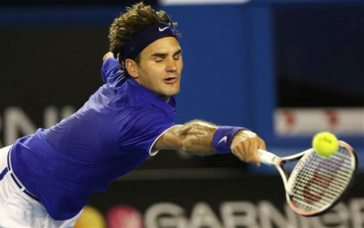 Switzerland's Roger Federer returns to Russia's Marat Safin during their men's singles match at the Australian Open in Melbourne.