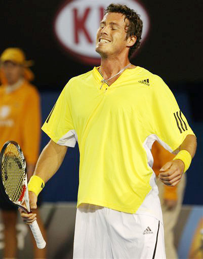 Russia's Marat Safin reacts as he plays Switzerland's Roger Federer during their men's singles match at the Australian Open in Melbourne.