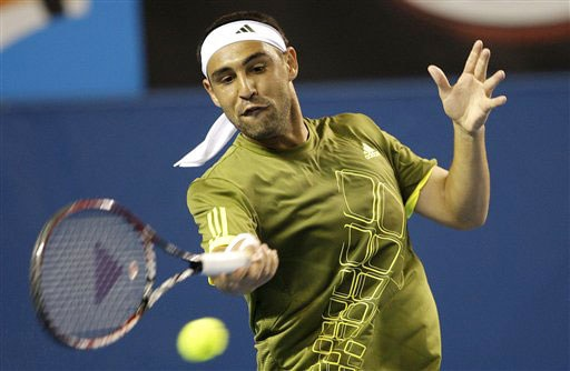 Marcos Baghdatis of Cyprus returns to Mardy Fish of the United States during their men's singles match at the Australian Open in Melbourne.
