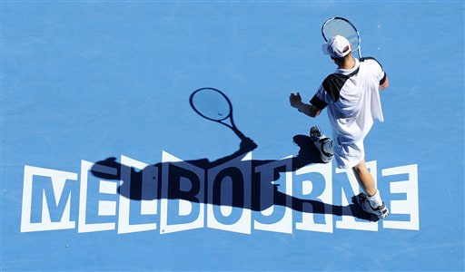 Andy Roddick of the United States in action as he plays Spain's Tommy Robredo during their men's singles match at the Australian Open in Melbourne on Sunday. (AP Photo)
