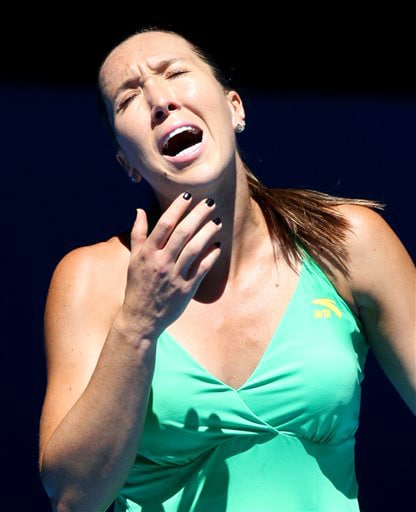 Serbia's Jelena Jankovic reacts after losing a point against France's Marion Bartoli during their women's singles match at the Australian Open in Melbourne on Sunday. (AP Photo)