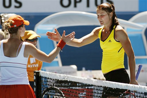 Russia's Dinara Safina shakes hands with France's Alize Cornet at the net after her victory during their women's singles match at the Australian Open in Melbourne on Sunday. (AP Photo)