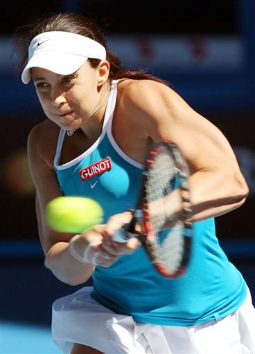 France's Marion Bartoli makes a return to Serbia's Jelena Jankovic during their women's singles match at the Australian Open in Melbourne on Sunday. (AP Photo)