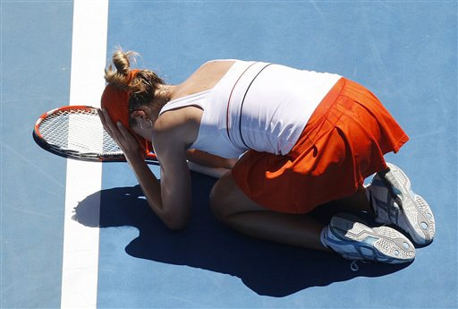 Alize Cornet of France reacts as she plays Russia's Dinara Safina during their women's singles match at the Australian Open in Melbourne on Sunday. (AP Photo)