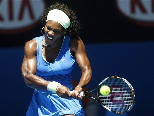 Serena Williams of the United States returns to Belarus's Victoria Azerenka during their women's singles match at the Australian Open in Melbourne on Monday. (AP Photo)