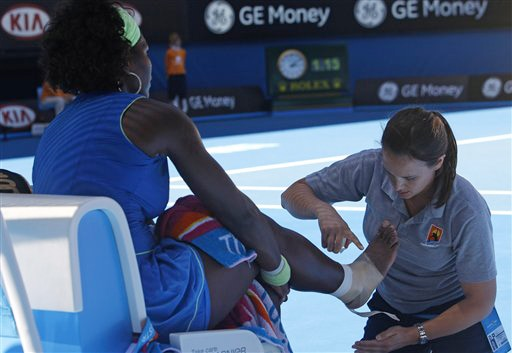 Serena Williams of the United States has her ankle and foot bandaged as she plays Belarus's Victoria Azarenka in a women's singles match at the Australian Open in Melbourne on Monday. (AP Photo)