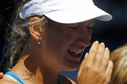 Belarus's Victoria Azarenka reacts after she had to retire injured from her women's singles match against Serena Williams of the United States at the Australian Open in Melbourne on Monday. (AP Photo)