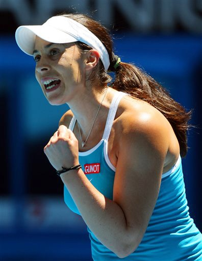 France's Marion Bartoli reacts after winning a point as she plays Russia's Vera Zvonareva in a women's singles match at the Australian Open in Melbourne on Tuesday. (AP Photo)
