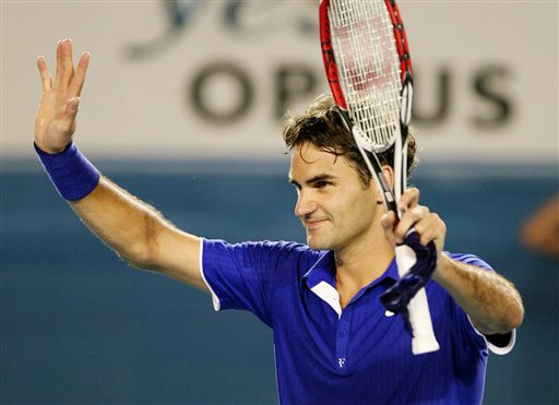 Switzerland's Roger Federer waves after winning over Argentina's Juan Martin Del Potro in their men's singles match at the Australian Open in Melbourne on Tuesday. (AP Photo)