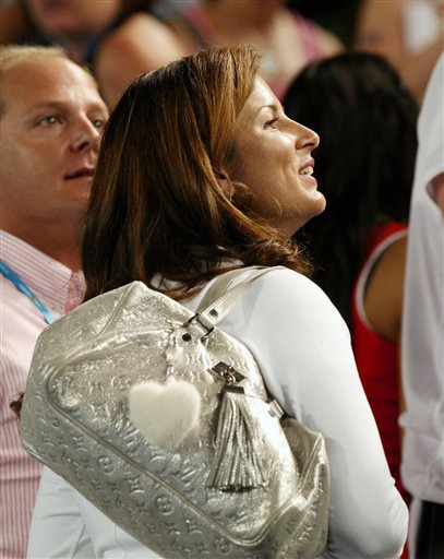 Mirka Vavrinec, girlfriend of Switzerland's Roger Federer, smiles as she watches his men's singles match against Argentina's Juan Martin Del Potro at the Australian Open in Melbourne on Tuesday. (AP Photo)