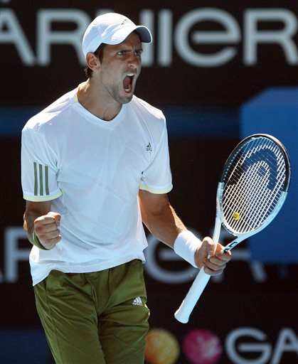 Serbia's Novak Djokovic reacts after winning a point against Andy Roddick of the United States in a men's singles match at the Australian Open in Melbourne on Tuesday. (AP Photo)