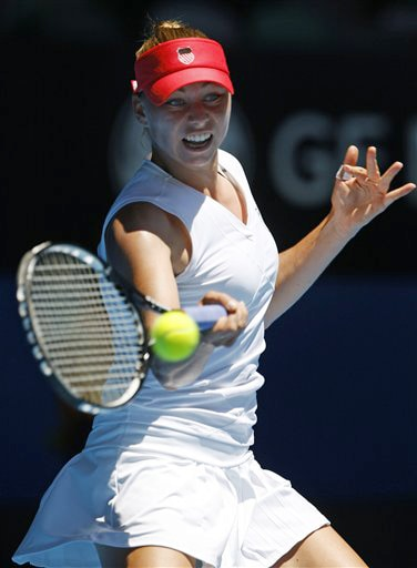 Russia's Vera Zvonareva returns to France's Marion Bartoli in a women's singles match at the Australian Open in Melbourne on Tuesday. (AP Photo)